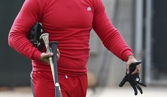 Cincinnati Reds' Matt Kemp heads back to the locker room after completing his voluntary workout at the Reds spring training baseball facility, Wednesday, Feb. 13, 2019, in Goodyear, Ariz. (AP Photo/Ross D. Franklin)