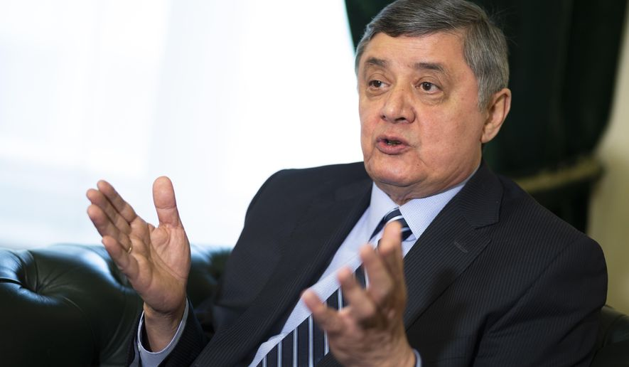 Russian presidential envoy to Afghanistan Zamir Kabulov gestures while speaking during an interview to the Associated Press in Moscow, Russia, Wednesday, Feb. 13, 2019. Kabulov said the U.S. has failed in Afghanistan and that helped open the way for Moscow to expand its clout as a mediator between Afghan factions. (AP Photo/Alexander Zemlianichenko)