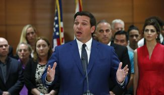 Florida Gov. Ron DeSantis speaks during a news conference, Wednesday, Feb. 13, 2019, in Fort Lauderdale, Fla. DeSantis ordered a statewide grand jury investigation on school safety. (AP Photo/Wilfredo Lee)