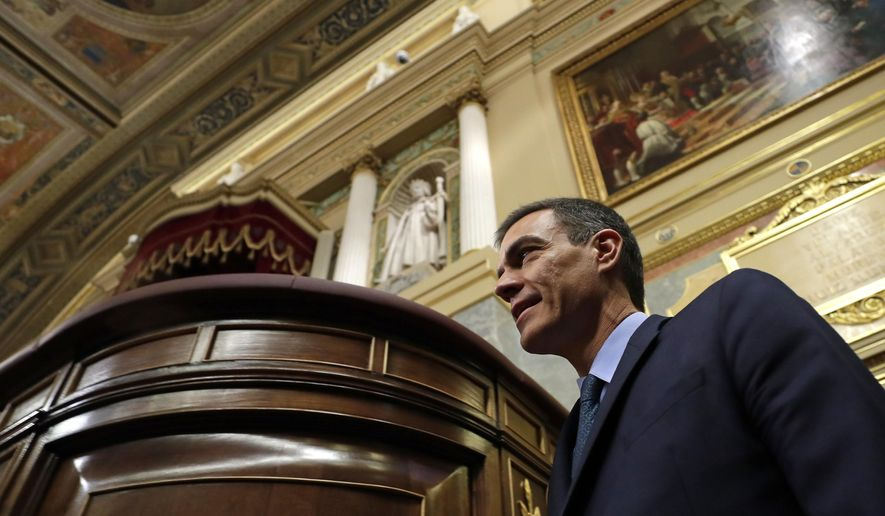 Spain's Prime Minister Pedro Sanchez arrives at the Spanish parliament in Madrid, Wednesday, Feb. 13, 2019. Spain's minority socialist government could be forced to call an early general election if Catalan separatist parties carry out their threat to reject the 2019 national budget in a crucial parliamentary vote Wednesday. (AP Photo/Manu Fernandez)