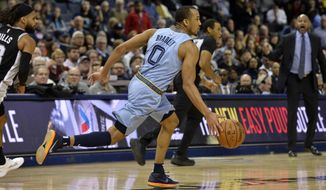 Memphis Grizzlies guard Avery Bradley (0) brings the ball up during the second half of the team's NBA basketball game against the San Antonio Spurs on Tuesday, Feb. 12, 2019, in Memphis, Tenn. (AP Photo/Brandon Dill)