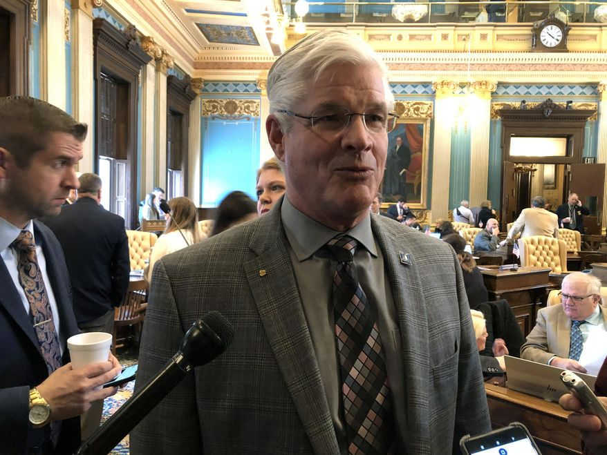 """Senate Majority Leader Mike Shirkey, R-Clarklake, speaks with reporters following the Senate session on Wednesday, Feb. 13, 2019, in Lansing, Mich. Shirkey says """"new revenue"""" is needed to improve Michigan's roads. (AP Photo/David Eggert)"""