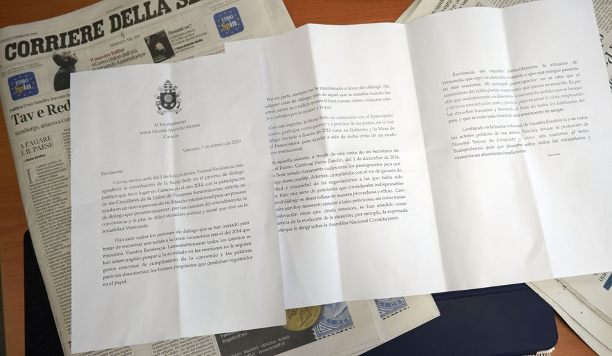 Reproduction of a three-page letter that Italian newspaper Corriere della Sera reported was written from Pope Francis to Venezuelan President Nicolas Maduro, in Rome, Wednesday, Feb. 13, 2019. Italian newspaper Corriere della Sera reported that Pope Francis has written a letter to Venezuelan President Nicolas Maduro indicating conditions aren't ripe for the Vatican to step in and help mediate in the country's political crisis. (AP Photo/Andrew Medichini)
