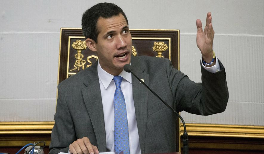 Venezuela' self proclaimed interim president and President of the National Assembly Juan Guaido, speaks during a session at the National Assembly, in Caracas, Venezuela, Wednesday, Feb. 13, 2019. Guaido said Wednesday that the National Assembly has appointed six executives to a transitional board for its PDVSA state-owned oil company and its U.S. subsidiaries, including Houston-based refiner Citgo. (AP Photo/Ariana Cubillos)