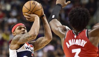 Washington Wizards guard Bradley Beal (3) shoots a 3-pointer over Toronto Raptors forward OG Anunoby (3) during the second half of an NBA basketball game Wednesday, Feb. 13, 2019, in Toronto. (Frank Gunn/The Canadian Press via AP) **FILE**