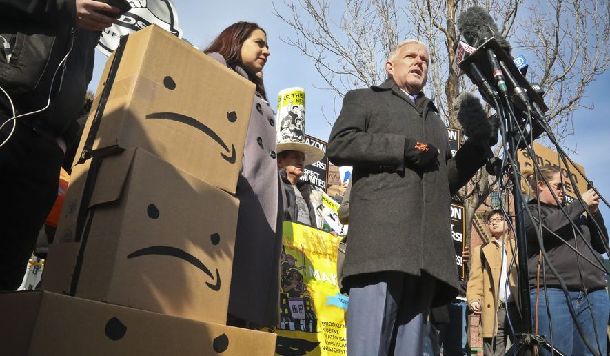 New York City Councilman Jimmy Van Bramer, center, speaks during a conference in Gordon Triangle Park in the Queens borough of New York, following Amazon's announcement it would abandon its proposed headquarters for the area, Thursday Feb. 14, 2019. (AP Photo/Bebeto Matthews)