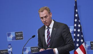 Acting U.S. Defense Secretary Patrick Shanahan talks to journalists during a press conference at the second day of a NATO defense ministers meeting at NATO headquarters in Brussels, Thursday, Feb. 14, 2019. NATO defense ministers are discussing the future of the alliance's operation in Afghanistan and how best to use its military presence to support political talks aimed at ending the conflict. (AP Photo/Francisco Seco)