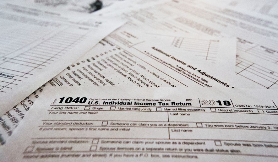 Receiving refunds at the end of the year, instead of having to write a check, has the pernicious effect of deluding many taxpayers into thinking that the government is paying them rather than the other way around. (Associated Press/File) **FILE**