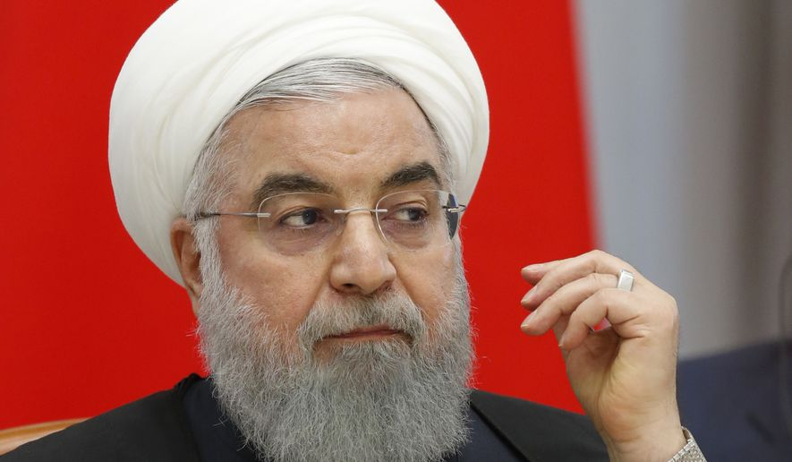 Iranian President Hassan Rouhani speaks during a meeting in the Bocharov Ruchei residence in the Black Sea resort of Sochi, Russia, Thursday, Feb. 14, 2019. Putin is hosting the leaders of Turkey and Iran for talks about a Syria peace settlement as expectations mount for an imminent and final defeat of the Islamic State group. (Sergei Chirikov/Pool Photo via AP)