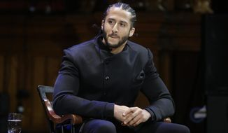 In this Oct. 11, 2018, file photo, former NFL football quarterback Colin Kaepernick attends the W.E.B. Du Bois Medal ceremonies at Harvard University in Cambridge, Mass. (AP Photo/Steven Senne, File)