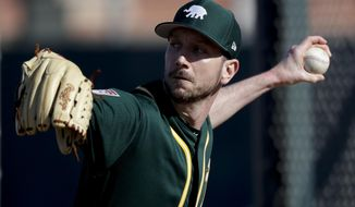 Oakland Athletics pitcher Jerry Blevins throws at their baseball spring training facility in Mesa, Ariz., Tuesday, Feb. 12, 2019. (AP Photo/Chris Carlson)
