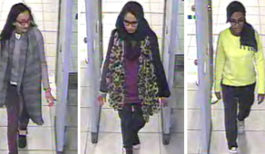 This Monday, Feb. 23, 2015, file handout image of a three image combo of stills taken from CCTV issued by the Metropolitan Police shows Kadiza Sultana, left, Shamima Begum, center, and Amira Abase going through security at Gatwick airport, south England, before catching their flight to Turkey. Shamima Begum told The Times newspaper in a story published on Thursday, Feb. 14, 2019, that she wants to come back to London. (Metropolitan Police via AP)
