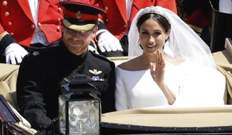 FILE - In this Saturday, May 19, 2018 file photo, Britain's Prince Harry and Meghan Markle leave Windsor Castle in a carriage after their wedding at St. George's Chapel in Windsor, near London, England. Nine months after her globally televised wedding extravaganza, the 37-year-old woman now formally known as the Duchess of Sussex is finding that life in the royal fishbowl carries not just glamour and great charitable opportunities but liabilities as well. (AP Photo/Matt Dunham, file)
