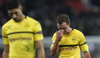 Dortmund midfielder Mario Gotze, right, reacts after losing the Champions League round of 16, first leg, soccer match between Tottenham Hotspur and Borussia Dortmund at Wembley stadium in London, England, Wednesday, Feb. 13, 2019. (AP Photo/Frank Augstein)