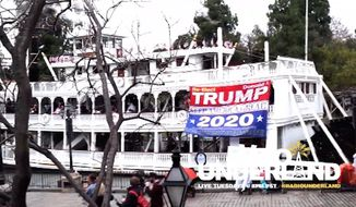 "Dion Cini, a former Marine from New York City who is known for his pro-President Trump antics, was at it again Wednesday after he unfurled a giant ""Trump 2020"" banner from the Mark Twain riverboat at Disneyland. (YouTube/@Radio Underland)"