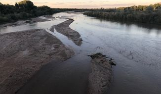 This Sept. 11, 2018 image shows sand bars developing in the Rio Grande as it flows through Albuquerque, New Mexico. National forecasters and climate experts warned Thursday, Feb. 14, 2019, that despite descent snowpack in some parts of the southwestern United States, already low soil moisture levels will keep more of the spring runoff from reaching streams, rivers and reservoirs. (AP Photo/Susan Montoya Bryan)