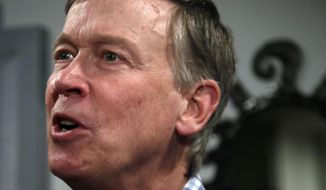 Former Colorado Gov. John Hickenlooper speaks at a campaign house party, Wednesday, Feb. 13, 2019, in Manchester, N.H. Hickenlooper is contemplating a run for the Democratic presidential candidacy. (AP Photo/Elise Amendola)