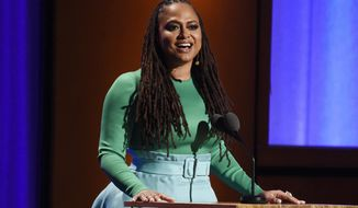 """FILE- In this Nov. 18, 2018, file photo filmmaker Ava DuVernay addresses the audience during the 2018 Governors Awards at The Ray Dolby Ballroom in Los Angeles. Italian brand Prada  said that DuVernay, will co-chair a diversity council to """"elevate voices of color within the company and fashion industry at large."""" (Photo by Chris Pizzello/Invision/AP, FIle)"""