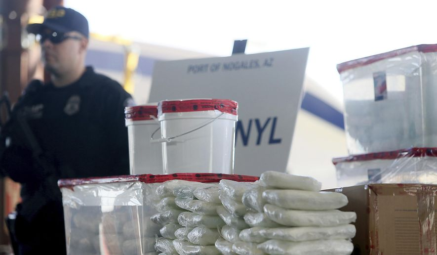 This Jan. 31, 2019, file photo shows a display of fentanyl and meth that was seized by Customs and Border Protection officers over the weekend at the Nogales Port of Entry at a press conference in Nogales, Ariz. (Mamta Popat/Arizona Daily Star via AP) ** FILE **