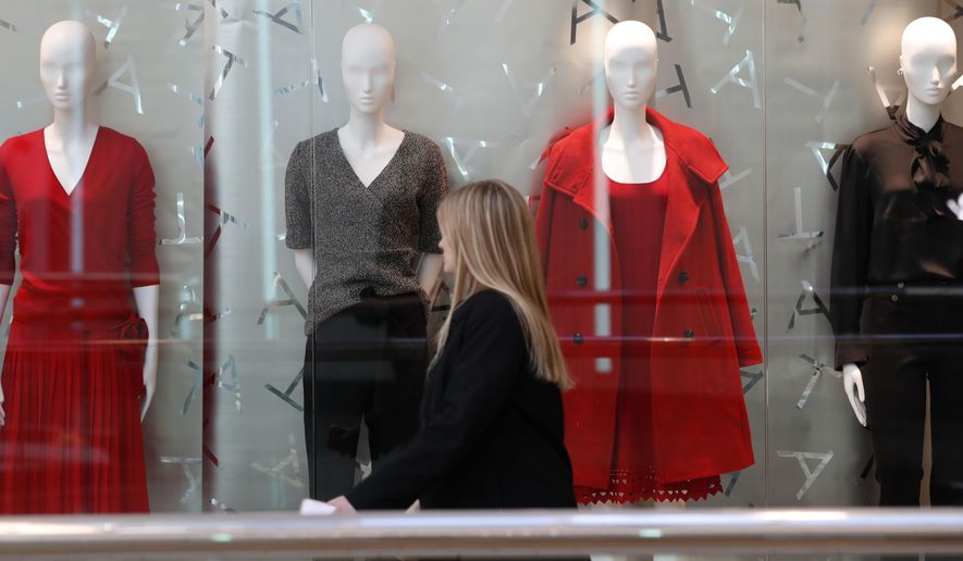 FILE- In this Dec. 24, 2018, file photo a woman walks by mannequins at the Cherry Creek Mall in Denver. The National Retail Federation, the nation's largest retail trade group, says that holiday sales increased a lower-than-expected 2.9 percent as worries about the trade war with China, the government shutdown and stock market turmoil dampened shopper spending in December. (AP Photo/David Zalubowski, File)