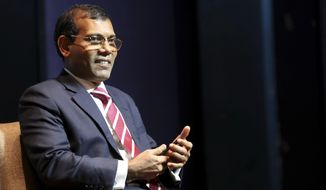 Former Maldives President Mohamed Nasheed takes a seat before delivering a lecture on climate change in New Delhi, India, Thursday, Feb. 14, 2019. In an interview to The Associated Press Thursday after giving a climate change lecture, Nasheed said the Indian Ocean archipelago nation is seeking tenders for renewable energy projects to help lessen the burden of foreign debt. (AP Photo/Manish Swarup)
