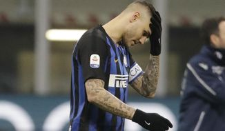 FILE - In this Sunday, Feb. 3, 2019 file photo, Inter Milan's Mauro Icardi walks off the pitch at the end of a Serie A soccer match between Inter Milan and Bologna, at the San Siro stadium in Milan, Italy. Two months ago, Mauro Icardi was one of Inter Milan's favored players, on Thursday, Feb. 14, 2019, he was training with just a handful of teammates at their training ground after a rapid fall from grace after Icardi and Inter have been in protracted talks over renewing his contract, which expires in 2021, with agent-wife Wanda Nara being particularly outspoken over the past month. (AP Photo/Luca Bruno, File)