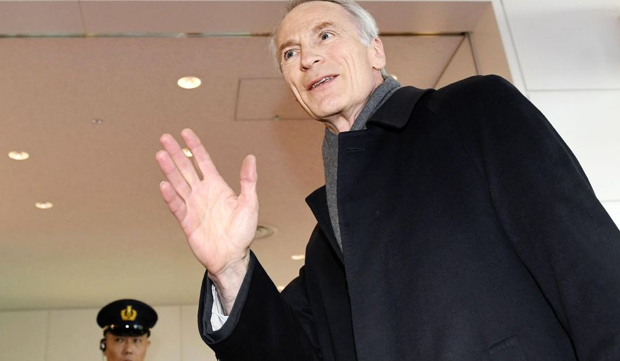 Renault Chairman Jean-Dominique Senard waves upon arrival at Haneda international airport in Tokyo Thursday, Feb. 14, 2019. Senard, who recently replaced Carlos Ghosn, is expected to meet Renault's alliance partner Nissan's Chief Executive Hiroto Saikawa for merging the two automakers under one holding company. (Akiko Matsushita/Kyodo News via AP)