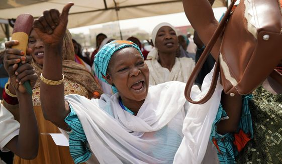 Nigerian women attend an inter-faith prayer rally organized by the Freedom and Justice Party in Abuja, Nigeria, Thursday Feb. 14, 2019. Incumbent President Muhammadu Buhari is to face opposition presidential candidate Atiku Abubakarin on Saturday, Feb. 16 in Nigeria's general election. (AP Photo/Jerome Delay)