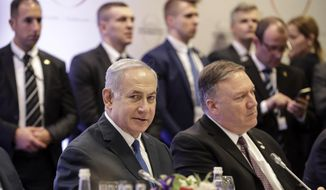 Israeli Prime Minister Benjamin Netanyahu, left, sits beside United State Secretary of State Mike Pompeo, right, at a conference on Peace and Security in the Middle East in Warsaw, Poland, Thursday, Feb. 14, 2019. The Polish capital is host for a two-day international conference, co-organized by Poland and the United States. (AP Photo/Michael Sohn)