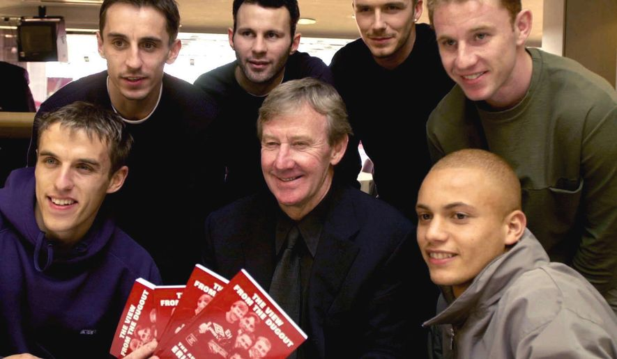 "FILE - In this March 1, 2001 file photo, Eric Harrison, centre, poses for a photo with Manchester United players from left, Gary Neville, Phil Neville, Ryan Giggs, David Beckham, Nicky Butt and Wes Brown during his book launch, at Old Trafford, in Manchester, England. Harrison, the Manchester United youth team manager who launched the career of David Beckham as part of the renowned group of ""Class of 92"" players, has died, it was reported on Thursday, Feb. 14, 2019.  (Rui Vieira/PA via AP, File)"