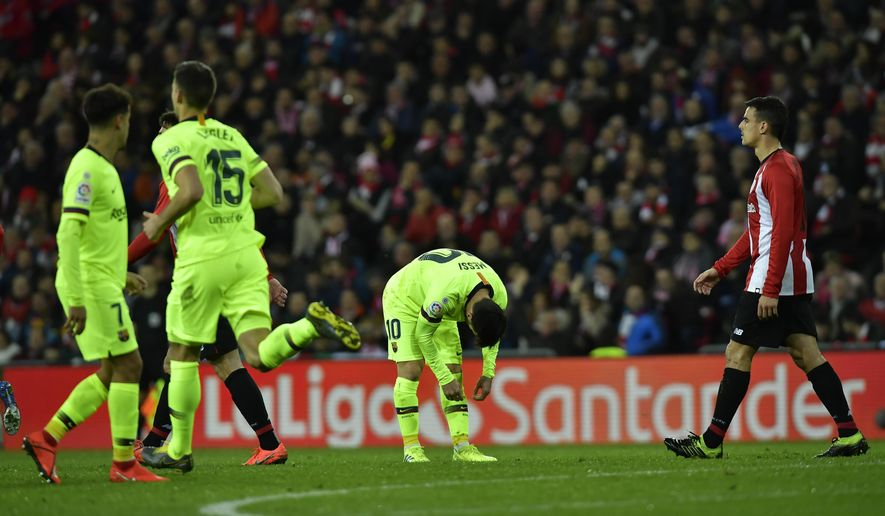 FC Barcelona's Lionel Messi, center, reacts during the Spanish La Liga soccer match between Athletic Bilbao and FC Barcelona at San Mames stadium, in Bilbao, northern Spain, Sunday, Feb. 10, 2019.(AP Photo/Alvaro Barrientos)