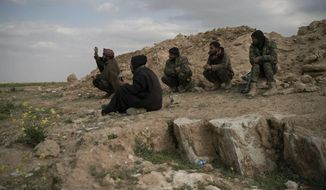 U S Backed Syrian Democratic Forces Sdf Fighters Sit Atop A Hill In The