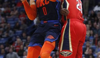 Oklahoma City Thunder guard Russell Westbrook (0) drives to the basket past New Orleans Pelicans forward Darius Miller (21) during the first half of an NBA basketball game in New Orleans, Thursday, Feb. 14, 2019. (AP Photo/Tyler Kaufman)