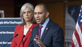 Rep. Hakeem Jeffries, D-N.Y., the Democratic Caucus chair, joined at left by Rep. Katherine M. Clark, D-Mass., left, Caucus vice chair, speaks with reporters at the Capitol in Washington, Wednesday, Feb. 13, 2019.  (AP Photo/J. Scott Applewhite)