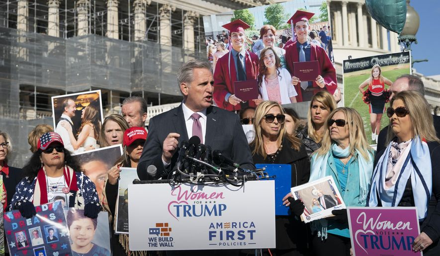 House Minority Leader Kevin McCarthy, R-Calif., joins supporters of President Donald Trump and family members of Americans killed by undocumented immigrants as they gather to to promote their support for a border wall with Mexico, at the Capitol in Washington, Wednesday, Feb. 13, 2019. (AP Photo/J. Scott Applewhite)