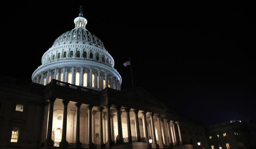 In this Feb. 5, 2019, file photo lights illuminate the U.S. Capitol dome in Washington. On Thursday, Feb. 14, the Labor Department reports on the number of people who applied for unemployment benefits last week. (AP Photo/Manuel Balce Ceneta, File)