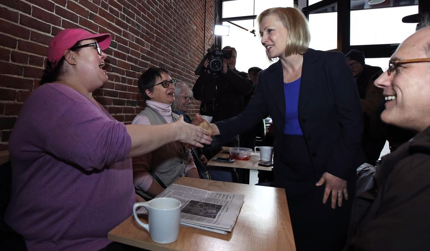 Sen. Kirsten Gillibrand, D-NY, shakes hands with a patron while visiting a coffee shop on Main Street in Concord, N.H., Friday, Feb. 15, 2019. Gillibrand visited New Hampshire as she explores a 2020 run for president. (AP Photo/Charles Krupa)