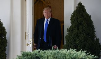President Donald Trump walks out of the Oval Office to deliver remarks in the Rose Garden at the White House to declare a national emergency in order to build a wall along the southern border, Friday, Feb. 15, 2019, in Washington. (AP Photo/ Evan Vucci)