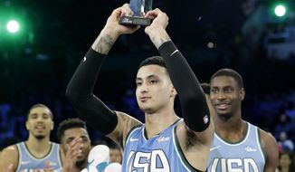 U.S. Team's Kyle Kuzma, of the Los Angeles Lakers holds the MVP trophy after the NBA All-Star Rising Stars basketball game between the World Team and the U.S. Team, Friday, Feb. 15, 2019, in Charlotte, N.C. The U.S. Team won 161-144. (AP Photo/Chuck Burton)