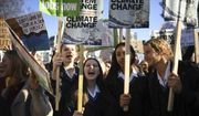Students join the Youth Strike 4 Climate movement during a climate change protest near Parliament in London, Friday Feb. 15, 2019.  The demonstration is one many nationwide to demand action against climate change. (Nick Ansell/PA via AP)