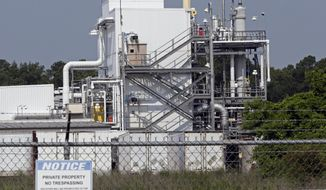 FILE - This June 15, 2018, file photo shows the Chemours Company's PPA facility at the Fayetteville Works plant near Fayetteville, N.C. where the chemical known as GenX is produced.   The EPA said in a violation notice letter this week that The Chemours Co. also failed to provide information showing when the company learned the chemical GenX contaminated water wells and properties around its factories near Fayetteville and Parkersburg, W. Va.. The agency says the violations found came after inspecting the two plants in 2017. (AP Photo/Gerry Broome, File)