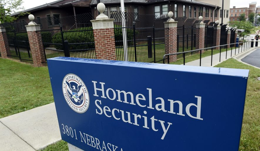 FILE - In this June 5, 2015, file photo, the Homeland Security Department headquarters in northwest Washington.  The Trump administration has announced new rules for scrutinizing petitions to bring in minor spouses to the United States.  (AP Photo/Susan Walsh, File)