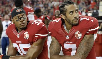 FILE - In this Sept. 12, 2016, file photo, San Francisco 49ers safety Eric Reid (35) and quarterback Colin Kaepernick (7) kneel during the national anthem before an NFL football game against the Los Angeles Rams, in Santa Clara, Calif. Colin Kaepernick and Eric Reid have reached settlements on their collusion lawsuits against the NFL, the league said Friday, Feb. 19, 2019.(AP Photo/Marcio Jose Sanchez) ** FILE **