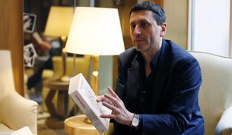 """French writer Frederic Martel gestures during an interview with Associated Press, in Paris, Friday, Feb. 15, 2019. In the explosive book """"In the Closet of the Vatican"""" author Frederic Martel describes a gay subculture at the Vatican and calls out the hypocrisy of Catholic bishops and cardinals who in public denounce homosexuality but in private lead double lives. (AP Photo/Thibault Camus)"""