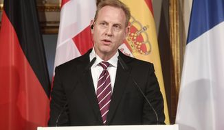 United States Secretary of Defense Patrick Shanahan talks to the media at a meeting of ministers of Defense during the International Security Conference in Munich, Germany, Friday, Feb. 15, 2019. (Tobias Hase/dpa via AP)