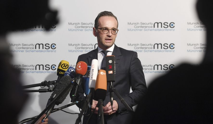 German Minister of Foreign Affairs Heiko Maas talks to the media at the Munich Security Conference in Munich, Germany, Friday, Feb. 15, 2019. (Tobias Hase/dpa via AP)