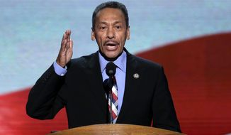 FILE - In this Sept. 6, 2012 file photo, Rep. Mel Watt of North Carolina addresses the Democratic National Convention in Charlotte, N.C. Mel Watt, the former director of the Federal Housing Finance Agency, misused his position when he attempted to coerce a female employee of the agency to engage in a personal relationship with him, according to a report from the agency's inspector general. The report finds that Watt, who stepped down as director in Jan. 2019, misused his official position in an attempt to obtain a personal benefit and was also not candid in answering questions about the incident.  (AP Photo/J. Scott Applewhite, File)