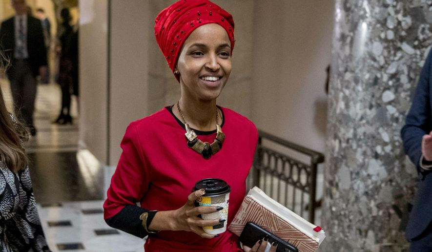 Rep. Ilhan Omar, D-Minn., walks through the halls of the Capitol Building in Washington. In Omar's Minnesota district, both Jews and Muslims voiced concern about an inflammatory tweet on Israel that had the congresswoman apologizing within hours. While some Jews said she was being unfairly judged, some others said they feared she was being slow to learn from previous criticism. (AP Photo/Andrew Harnik, File)