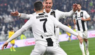 Juventus' Cristiano Ronaldo celebrates with his teammate Paulo Dybala after scoring during the Serie A soccer match between Juventus and Frosinone at the Allianz Stadium in Turin, Italy,  Friday, Feb. 15, 2019. (Alessandro Di Marco/ANSA via AP)