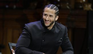 FILE - In this Oct. 11, 2018, file photo, former NFL football quarterback Colin Kaepernick smikes on stage during W.E.B. Du Bois Medal ceremonies at Harvard University, in Cambridge, Mass. Colin Kaepernick and Eric Reid have reached settlements on their collusion lawsuits against the NFL, the league said Friday, Feb. 19, 2019. (AP Photo/Steven Senne, File) **FILE**